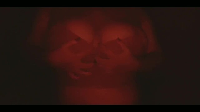 Self groping Big Natural tits in Red light with tiny top