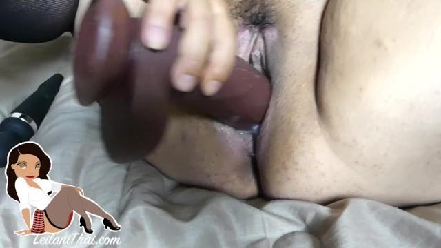 Amateur Asian slut MILF fucks her creamy cunt with a big black dildo